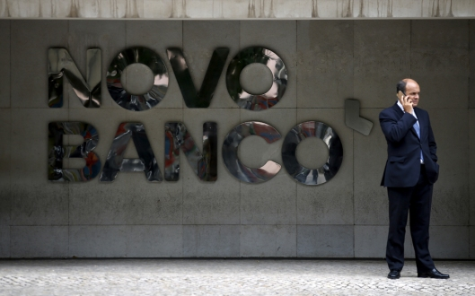 A man uses a mobilephone outside Novo Banco's headquarters in Lisbon, Portugal September 15, 2015. Portugal has failed to sell Novo Banco, the bank carved out of Banco Espirito Santo after a 4.9 billion euro rescue in 2014, ending talks with all bidders as their offers remained too low, sources said on Tuesday. REUTERS/Rafael Marchante TPX IMAGES OF THE DAY - RTS16YY